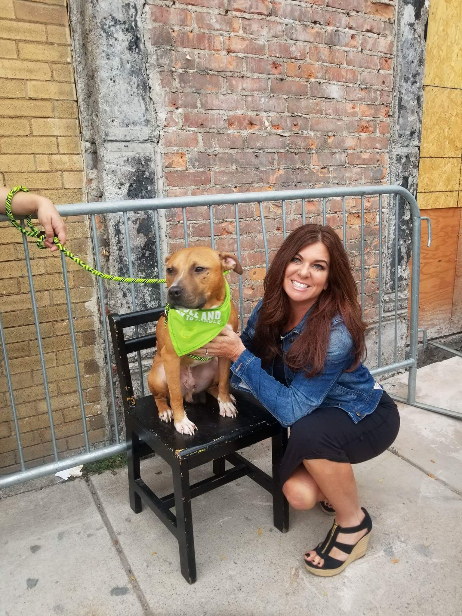 Christine from Wag 'N' Tails posing with pit bull dogs